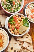 stock photo of pita  - Chickpea salad with tabbouleh and pita bread - JPG