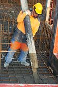 pic of formwork  - builder worker standing near trailer - JPG