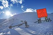 stock photo of avalanche  - Avalanche Blasting Sign Saying - JPG