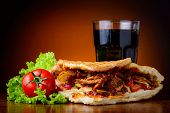 stock photo of kebab  - still life with doner kebab fresh vegetables and cola drink - JPG