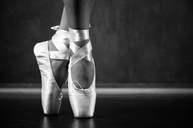 foto of stocking-foot  - Young ballerina dancing closeup on legs and shoes  - JPG