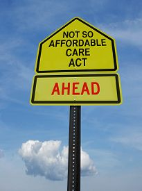 picture of sarcastic  - conceptual sign with words not so affordable care act ahead over blue sky - JPG