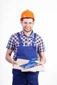 foto of grout  - Portrait of a young male tiler with ceramic tiles and grout float - JPG