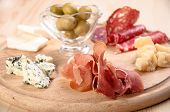 stock photo of cheese platter  - Italian antipasto with ham olive cheese and salami - JPG