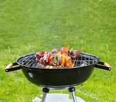 image of kababs  - Meat and vegetable skewer on barbecue grill with fire - JPG