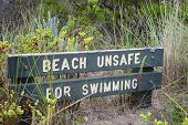 stock photo of unsafe  - Sign indicating that the beach is unsafe for swimming - JPG