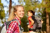 stock photo of candid  - Hiking woman portrait smiling happy in forest - JPG