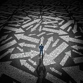 foto of confuse  - Confused businessman concept as a man standing on a road making a decision on a path to take with a group of arrows going in many directions - JPG