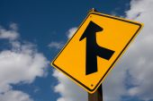 stock photo of merge  - A yellow US road sign offering direction - JPG