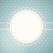 picture of doilies  - Lace doily border on a blue textured polka dot background - JPG