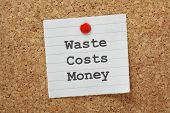 foto of waste management  - The phrase Waste Costs Money typed on a piece of lined paper and pinned to a cork notice board - JPG