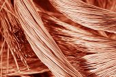 stock photo of raw materials  - Big pile of rufous copper wire close-up