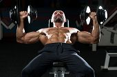picture of work bench  - Mature Men Doing Dumbbell Incline Bench Press Workout In Gym - JPG
