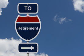 picture of retirement  - Retirement this way Blue and Red Interstate Sign with word Retirement and an arrow with sky background - JPG
