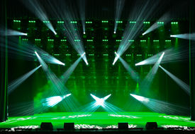 stock photo of soffit  - Illuminated empty concert stage with smoke and rays of light - JPG