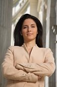 foto of fussy  - businesswoman in challenging pose between columns looking at you - JPG