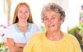 stock photo of geriatric  - Photo of happy elderly woman with her caregiver - JPG