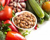 pic of pinto  - Raw pinto beans and vegetables isolated on white - JPG
