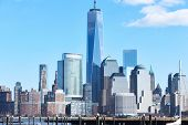 stock photo of trade  - New York City Manhattan skyline with One World Trade Center Tower  - JPG