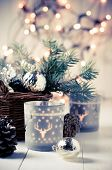 stock photo of wooden basket  - Vintage Christmas decor old Christmas decorations in a basket lanterns garlands and spruce branches on a white table - JPG