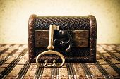 picture of chest  - Closed decorative chest with old metal key - JPG