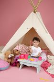 foto of teepee  - Toddler child kid engaged in pretend play with food stuffed toys and teepee tent - JPG