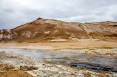 picture of gases  - Geothermal region of Hverir in Iceland near Myvatn Lake with fumaroles venting pressurised gases sulphur springs and hot boiling mud from volcanic activity - JPG