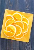 foto of valencia-orange  - fresh orange on the yellow plate and on a table - JPG