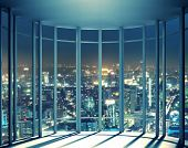 stock photo of breathtaking  - Night view of buildings from high rise window - JPG