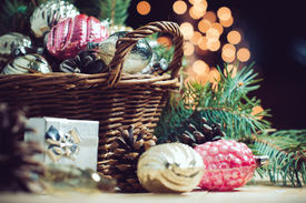 pic of gift basket  - Vintage Christmas decorations in a wicker basket Christmas gift in retro style Christmas garlands cozy home decor - JPG