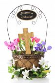 pic of risen  - A basket containing a wooden cross and surrounded by colorful tulips - JPG