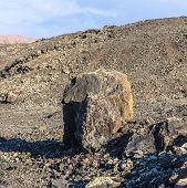 pic of volcanic  - Volcanic bomb in front of volcano Montana Colorada in Lanzarote Canary Islands Spain - JPG
