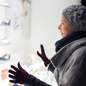 image of boutique  - Casualy winter dressed lady window shopping in front of sinfully expensive boutique store dispaly window - JPG