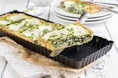 stock photo of pie-in-face  - Mozzarella Spinach Tarte - JPG