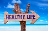 picture of peace-sign  - Healthy Life wooden sign with beach background  - JPG