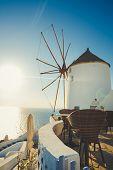 stock photo of windmills  - The famous Santorini Island in Greece - JPG