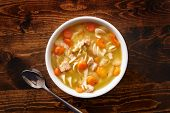 picture of chicken  - bowl of chicken noodle soup shot top down - JPG
