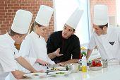 stock photo of student  - Chef training students in restaurant kitchen - JPG