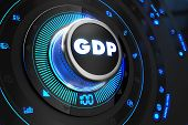 image of depreciation  - GDP Button with Glowing Blue Lights on Black Console - JPG