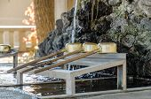 picture of trough  - Brass dipper arranged in front of Purification trough in Shinto shrines and Buddhist temple Japan - JPG