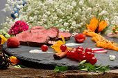 picture of duck  - slices of duck fried meat in fancy food arrangement - JPG