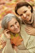 pic of daughter  - Mother and her nice daughter in autumn park - JPG