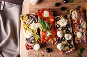 stock photo of cutting board  - Different sandwiches with vegetables and cheese on cutting board on table close up - JPG