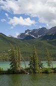 foto of shoreline  - Selecitve focus on a sliver on shoreline in a emerald green lake located in Jasper National Park Alberta Canada - JPG