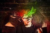 picture of witch  - Halloween witch with an unusual makeup and headdress of bats creates magic - JPG