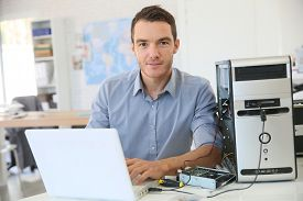 stock photo of microchips  - Engineer proceeding to data recovery from computer - JPG