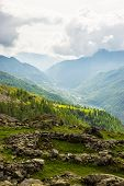 image of italian alps  - Dramatic sky in amazing green alpine valley in spring season - JPG
