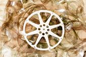 picture of mm  - Cinema movie reel and 35 mm unrolled filmstrip background - JPG