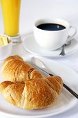 stock photo of orange-juice  - continental breakfast of coffee orange juice and croissants - JPG