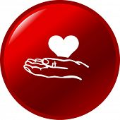stock photo of hand heart  - hand holding a heart button - JPG